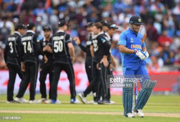 Dhoni of India walks off after being dismissed during the SemiFinal match of the ICC Cricket World Cup 2019 between India and New Zealand at Old...