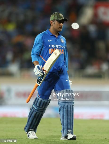 Dhoni of India walks off after he was dismissed during game three of the One Day International series between India and Australia at JSCA...