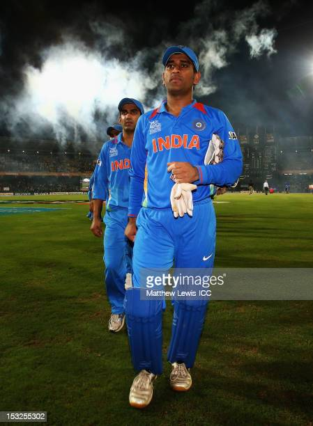 Dhoni of India walks off with his team after his team are knocked out of the Super Eights during the ICC World Twenty20 2012 Super Eights Group 2...