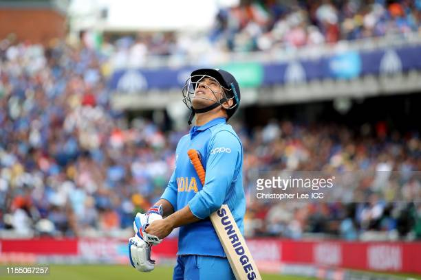 Dhoni of India walks out onto the pitch during the Group Stage match of the ICC Cricket World Cup 2019 between India and Australia at The Oval on...
