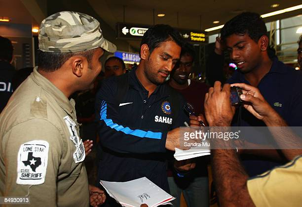 Dhoni of India walks through the arrivals hall as the Indian cricket team arrive at Auckland International Airport on February 20 2009 in Auckland...