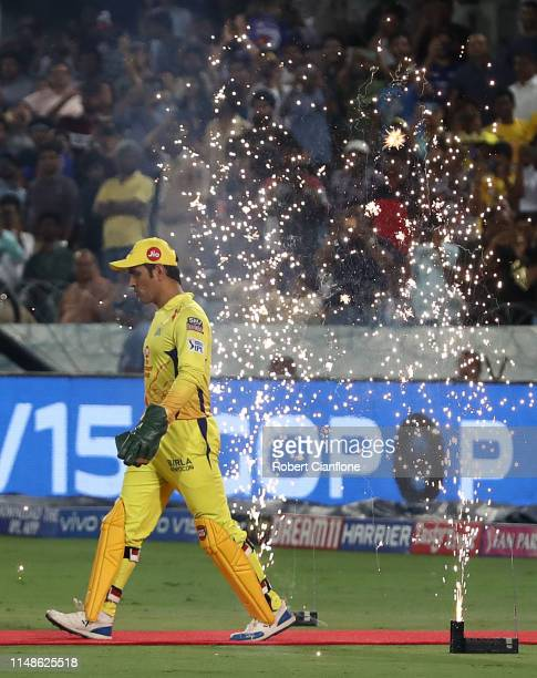 Dhoni of the Chennai Super Kings heads out to field during the Indian Premier League Final match between the the Mumbai Indians and Chennai Super...