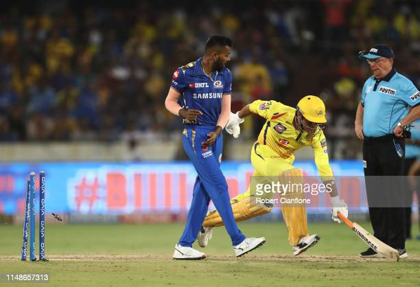 Dhoni of the Chennai Super Kings is run out during the Indian Premier League Final match between the the Mumbai Indians and Chennai Super Kings at...
