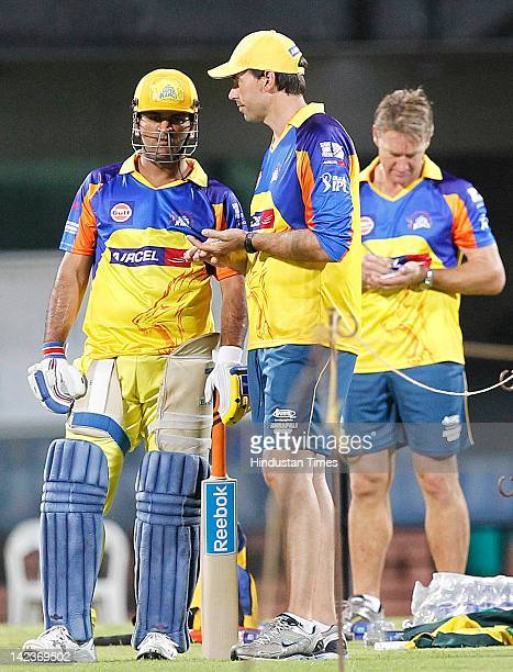 Dhoni of the Chennai Super Kings talks with coach Stephen Fleming as bowling coach Andy Bichel looks on during net practice at M.A Chidambaram...