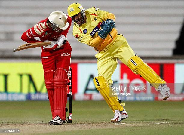 Dhoni takes a delivery behind Manish Pandey during the Airtel Champions League Twenty20 semifinal match between Chennai Super Kings and Royal...