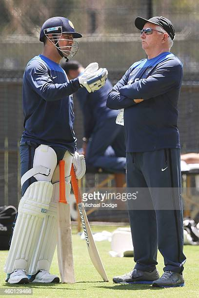 Dhoni talks to coach Duncan Fletcher during an India Training Session at Adelaide Oval on December 8 2014 in Adelaide Australia Dhoni was earlier...