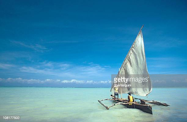 dhow at the coast of zanzibar - zanzibar island stock photos and pictures