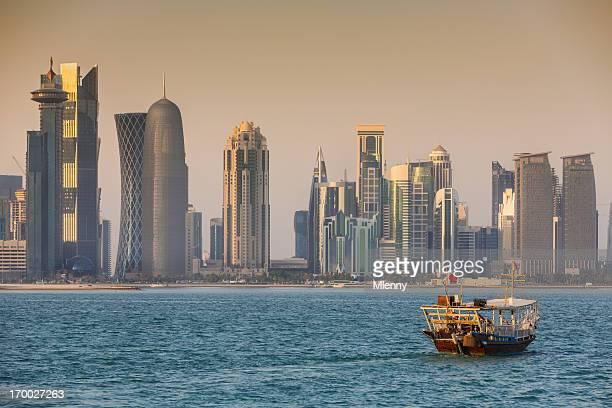 Dhow cruising to modern Doha Skyline, Qatar
