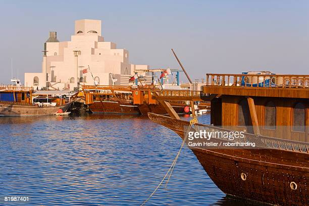 Dhow in front of the Museum of Islamic Art, designed by the renowned architect IM Pei, which has the largest collection of Islamic art in the world, Doha, Qatar, Middle East