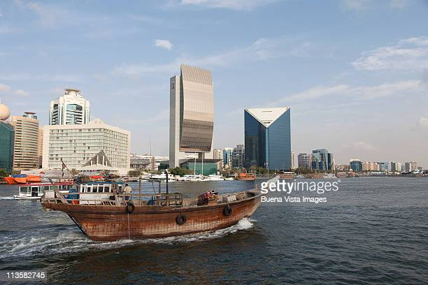 dhow on dubai creek - fishing boat stock pictures, royalty-free photos & images