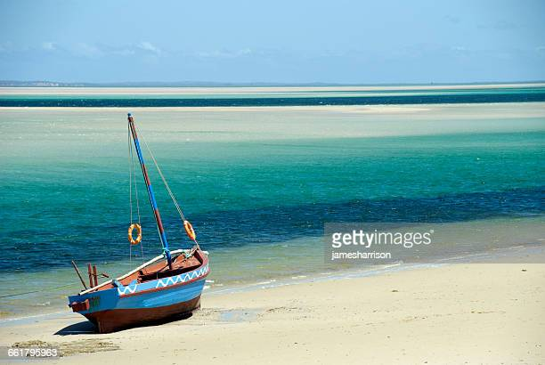 a dhow on the beach, inhambane, mozambique - mozambique stock pictures, royalty-free photos & images