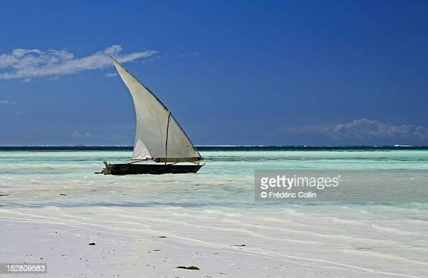 Dhow on turquoise sea of Zanzibar, Tanzania