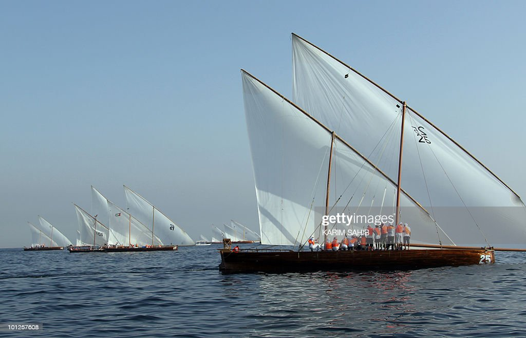A dhow (R) owned by the Crown Prince of Abu Dhabi, Sheikh Mohammed bin Zayed Al Nahyan, sails off the coast of Dubai during the Al-Gaffal 60 ft traditional dhow sailing race between the island of Sir Bu Nair, near the Iranian coast, and the Gulf emirate on May 29, 2010.