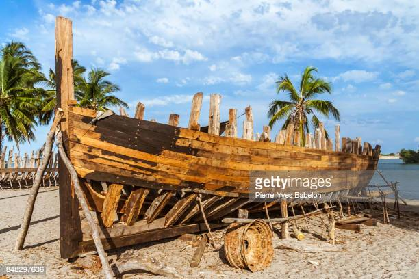 dhow under construction - pirate ship stock photos and pictures