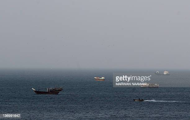 Dhows fishing boats and cargo ships are seen in the Strait of Hormuz at Khasab area of Oman on January 14 2011 Iran has responded to western threats...