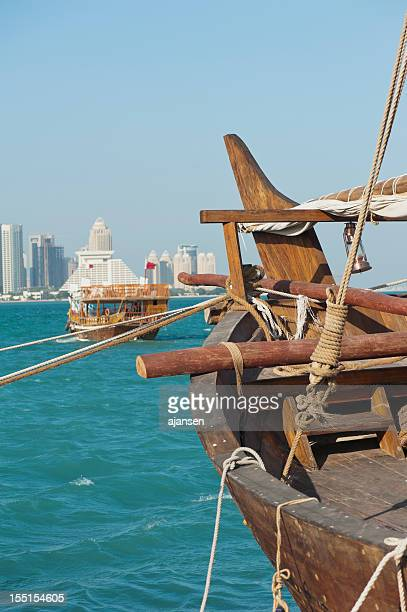 Dhows in the harbor of Doha, Qatar on clear day