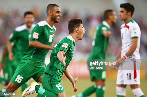 Dhurgham Ismael of Iraq celebrates kicking a penalty goal in extra time during the 2015 Asian Cup match between Iran and Iraq at Canberra Stadium on...