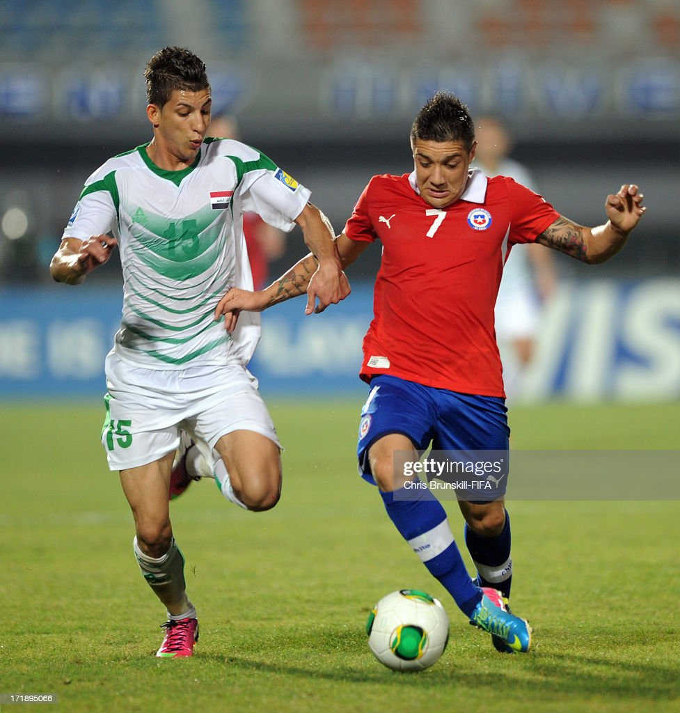 Dhurgham Ismael (L) of Iraq in action with Christian Bravo of Chile during the FIFA U20 World Cup Group E match between Iraq and Chile at Akdeniz University Stadium on June 29, 2013 in Antalya, Turkey.