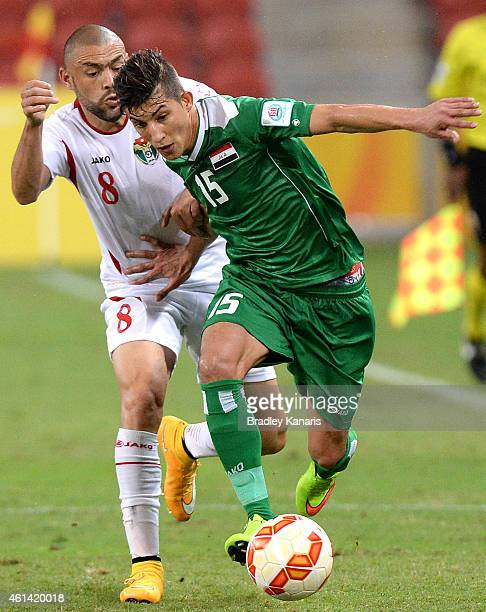 Dhurgham Ismael of Iraq is challenged by Odai Al Saify of Jordan during the 2015 Asian Cup match between Jordan and Iraq at Suncorp Stadium on...