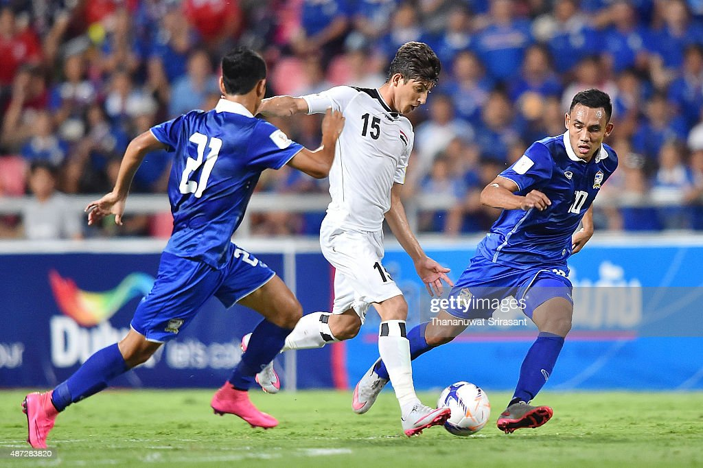 Dhurgham Ismail #15 of Iraq and Teerasil Dangda #10 of Thailand competes during the 2018 FIFA World Cup Qualifier match between Thailand and Iraq at Rajamangala Stadium on September 8, 2015 in Bangkok, Thailand.