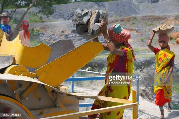 Dhurwa tribe women and men work in a stone quarry in the State of Chhattisgarh on November 18, 2013 in Chhattisgarh, India.