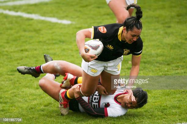 Dhys Faleafaga of Wellington is tackled by Florida Fatanitavake of North Harbour during the Farah Cup SemiFinal match between Wellington and North...