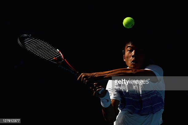 Di Wu of China returns a shot to Marin Cilic of Croatia during day three of the China Open at the National Tennis Center on October 3 2011 in Beijing...