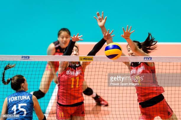 Di Yao and Yuanyuan Wang of China blocks Antonela Fortuna of Argentina during the FIVB Volleyball Nations League Hong Kong match between China and...