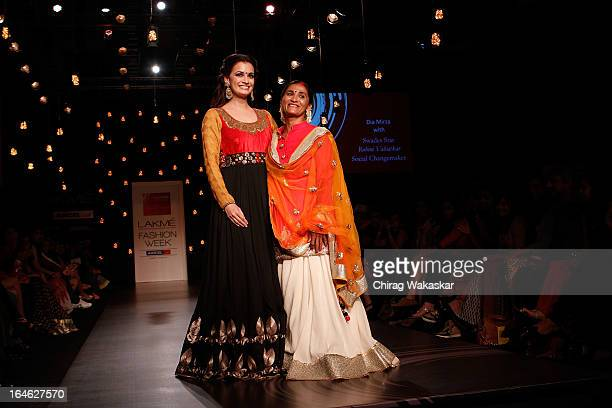 Dia Mirza & Rohini Valratkar showcase designs by Vikram Phadnis on the runway during day four of Lakme Fashion Week Summer/Resort 2013 on March 25,...