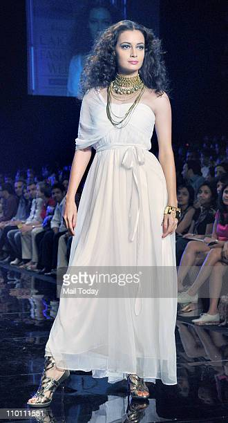 Dia Mirza showcases the creation of designer Rocky S on the 4th day of the Lakme Fashion week Summer Resort 2011 in Mumbai