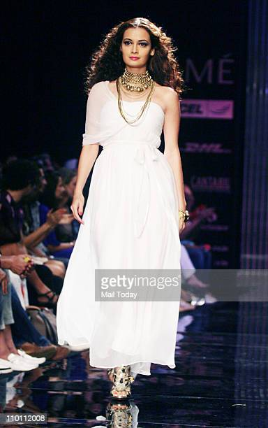 Dia Mirza showcases the creation of designer Rocky S on the 4th day of the Lakme Fashion week Summer Resort 2011 in Mumbai.