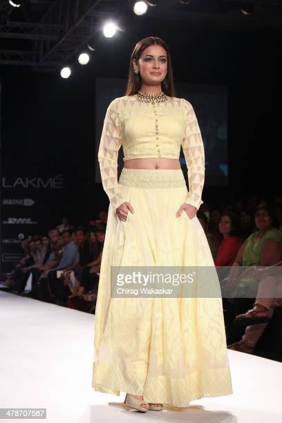 Dia Mirza walks the runway wearing designs by Anita Dongre at day 4 of Lakme Fashion Week Summer/Resort 2014 at the Grand Hyatt on March 14 2014 in...