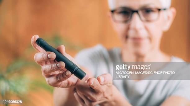 diabetes blood sugar test at home - diabetes stock pictures, royalty-free photos & images