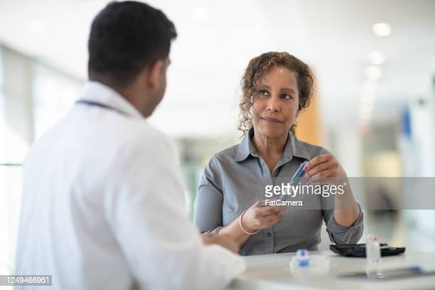 diabetes consulting - insulin stock pictures, royalty-free photos & images