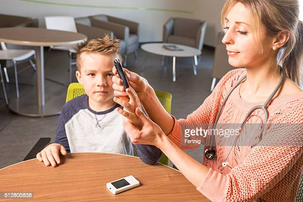 Diabetes health care specialist with a young diabetes patient