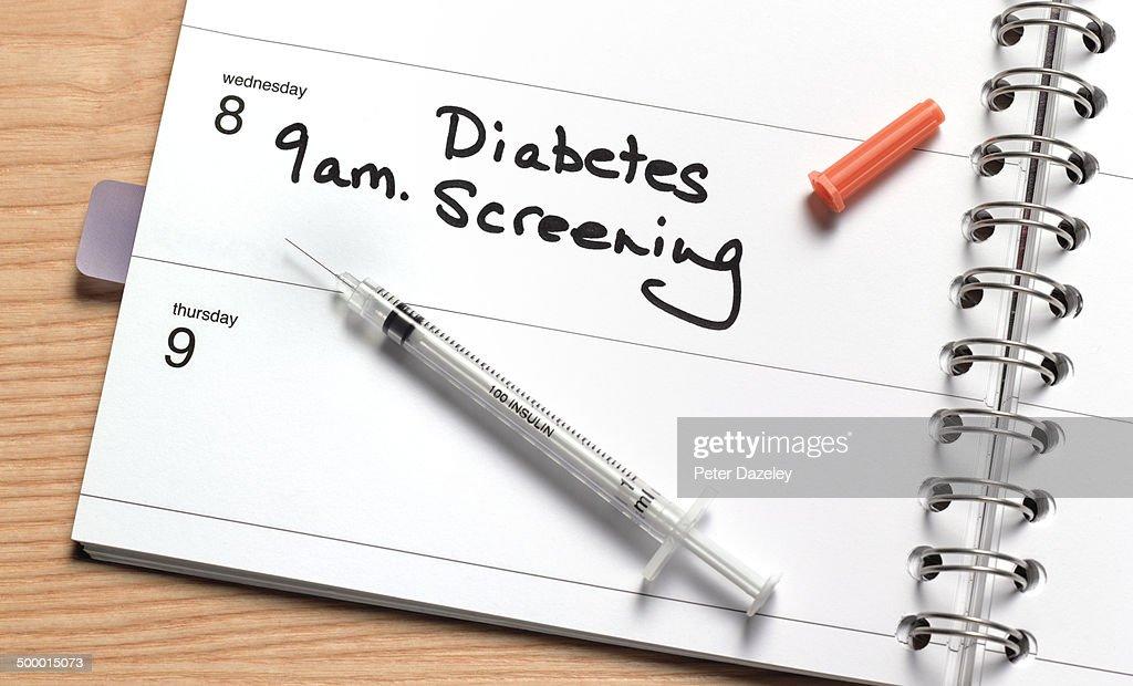 Diabetes screening in diary : Stock Photo