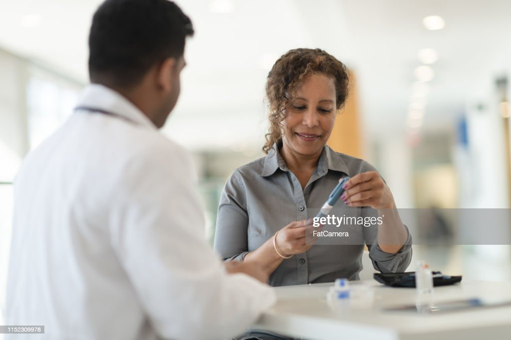 Diabetic patient meets with her doctor : Stock Photo