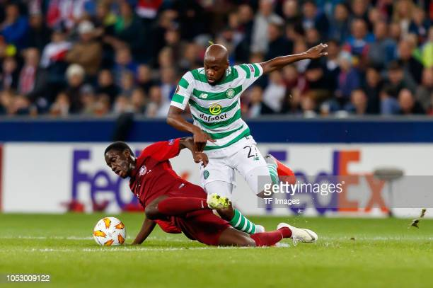 Diadie Samassekou of FC Salzburg and Youssouf Mulumbu of Celtic battle for the ball during the UEFA Europa League Group B match between FC Salzburg...