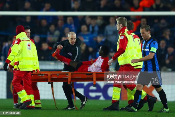 Diadie Samassekou of FC Salzburg leaves injured the pitch during the UEFA Europa League Round of 32 First Leg match between Club Brugge and RB...