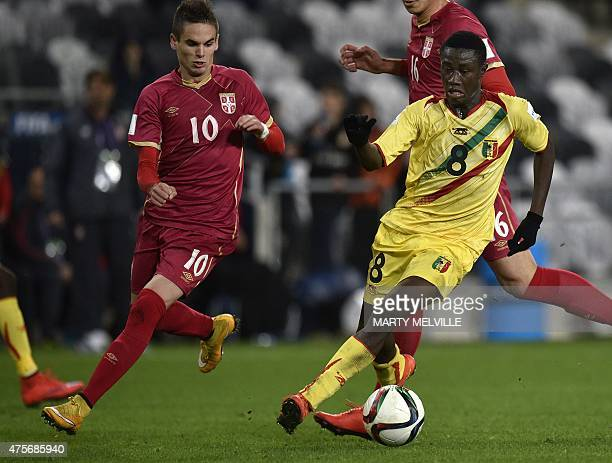 Diadie Samassekou of Mali is challenged by Mijat Gacinovic of Serbia during the FIFA Under20 World Cup football match between Serbia and Mali at...
