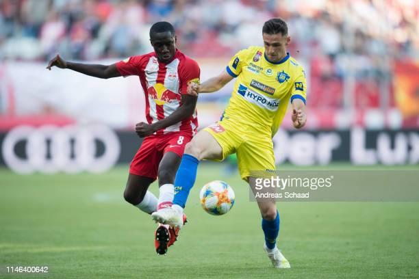Diadie Samassekou of Salzburg and Husein Balic of St. Poelten in action during the tipico Bundesliga match between RB Salzburg and SKN St. Poelten at...