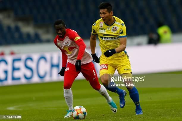 Diadie Samassekou of Salzburg and KwangRyong Pak of St Poelten during the tipico Bundesliga match between RB Salzburg and SKN St Poelten at Red Bull...