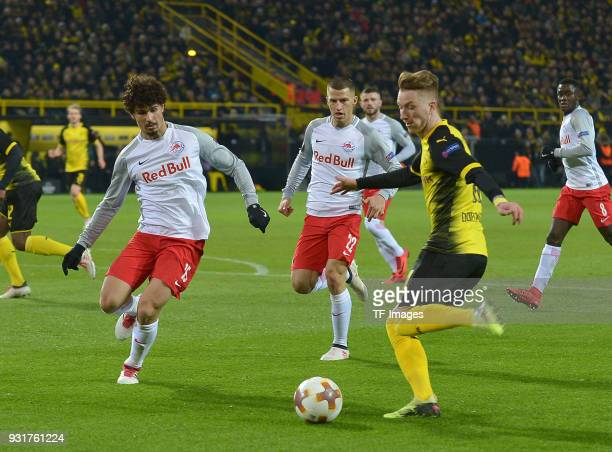 Diadie Samassekou of Salzburg and Marco Reus of Dortmund battle for the ball during UEFA Europa League Round of 16 match between Borussia Dortmund...