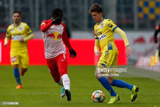 Diadie Samassekou of Salzburg and Robert Ljubicic of St Poelten during the tipico Bundesliga match between RB Salzburg and SKN St Poelten at Red Bull...