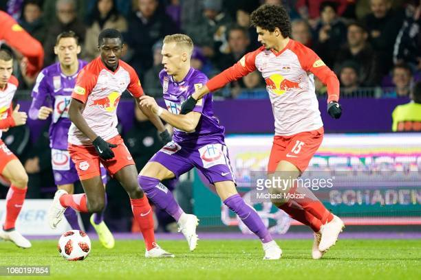 Diadie Samassekou of Salzburg Christoph Monschein of Austria Wien and Andre Ramalho of Salzburg fight for the ball during the tipico Bundesliga match...