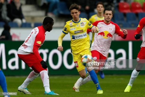 Diadie Samassekou of Salzburg Robert Ljubicic of St Poelten and Zlatko Junuzovic of Salzburg during the tipico Bundesliga match between RB Salzburg...