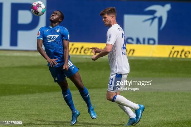 Diadie Samassekou of TSG 1899 Hoffenheim and Klaas-Jan Huntelaar of FC Schalke 04 battle for the ball during the Bundesliga match between TSG...