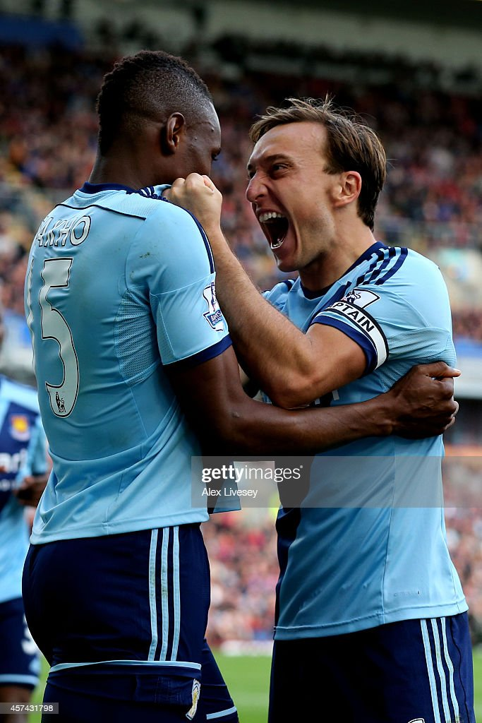 Diafra Sakho of West Ham celebrates with teammate Mark Noble after scoring the opening goal with a header during the Barclays Premier League match between Burnley and West Ham United at Turf Moor on October 18, 2014 in Burnley, England.