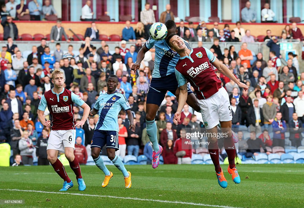 Diafra Sakho of West Ham rises above Jason Shackell of Burnley to score the opening goal with a header during the Barclays Premier League match between Burnley and West Ham United at Turf Moor on October 18, 2014 in Burnley, England.