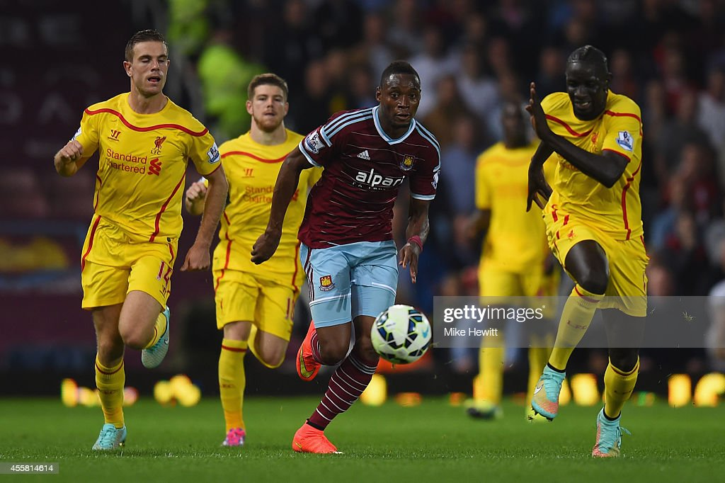 Diafra Sakho of West Ham runs at the Liverpool defence during the Barclays Premier League match between West Ham United and Liverpool at Boleyn Ground on September 20, 2014 in London, England.